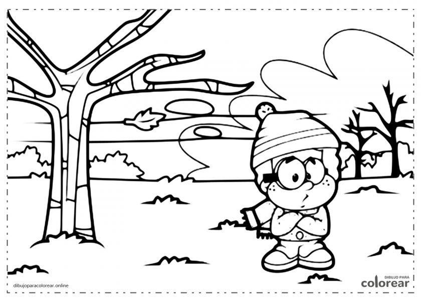 Niño con bufanda con frío en un paisaje invernal