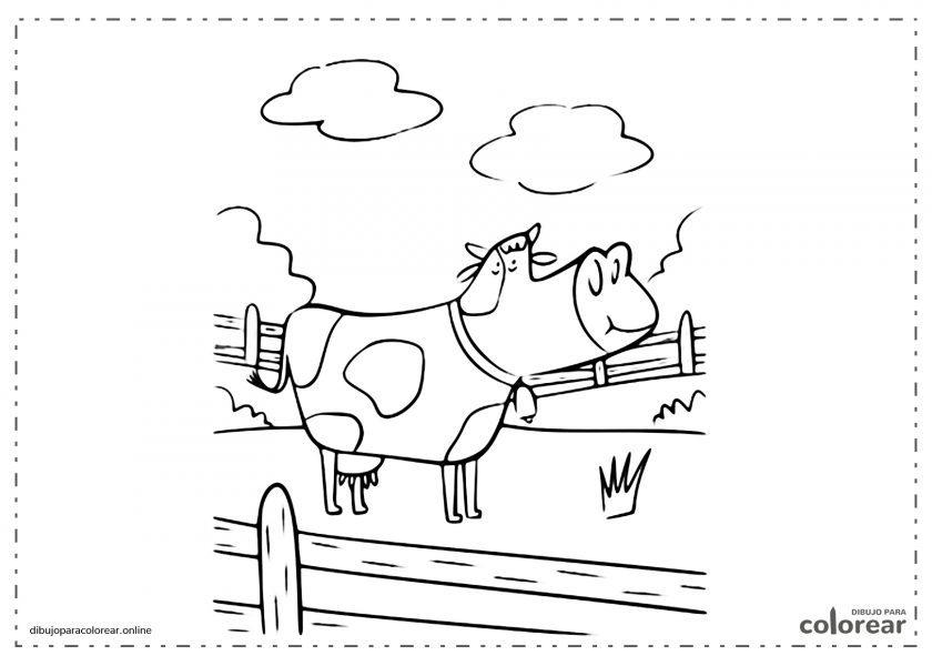 Vaca detrás de una valla en el campo